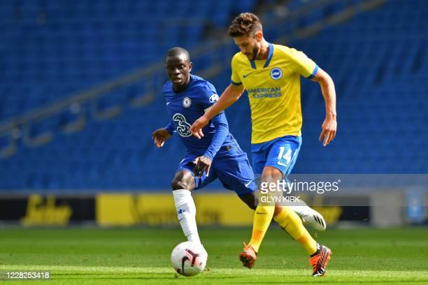 Brighton's English midfielder Adam Lallana vies with Chelsea's French midfielder N'Golo Kante during the preseason friendly football match between...