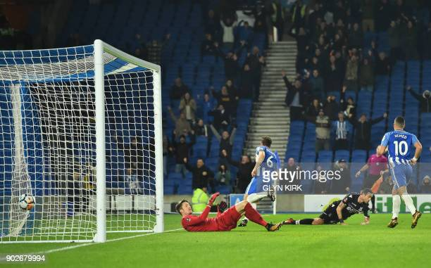 Brighton's English midfielder Dale Stephens scores past Crystal Palace's Welsh goalkeeper Wayne Hennessey during the English FA Cup third round...