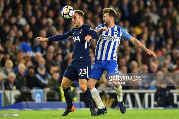 Brighton's English midfielder Dale Stephens vies with Tottenham Hotspur's Danish midfielder Christian Eriksen during the English Premier League...