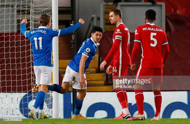 Brighton's English midfielder Steven Alzate celebrates scoring the opening goal during the English Premier League football match between Liverpool...