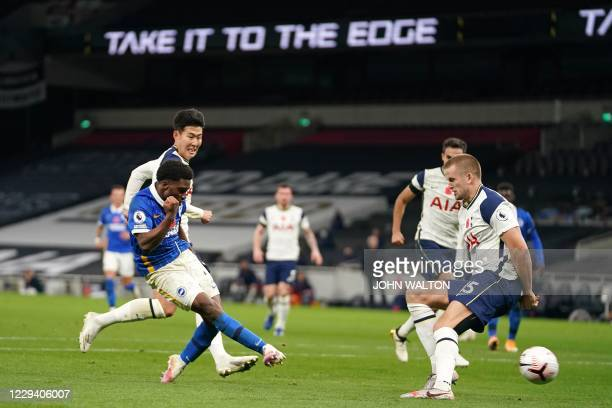 Brighton's English midfielder Tariq Lamptey shoots to score the equalising goal past Tottenham Hotspur's English defender Eric Dier during the...