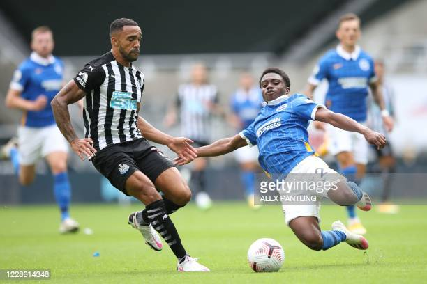 Brighton's English midfielder Tariq Lamptey tackles Newcastle United's Brazilian striker Joelinton during the English Premier League football match...