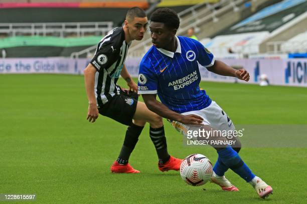 Brighton's English midfielder Tariq Lamptey vies with Newcastle United's Paraguayan midfielder Miguel Almiron during the English Premier League...