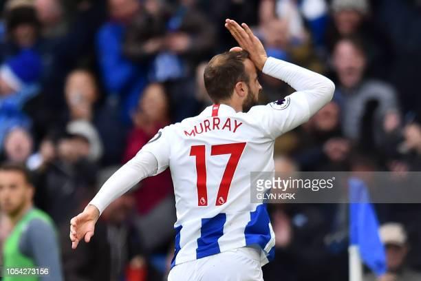 Brighton's English striker Glenn Murray celebrates after scoring his 100th Brighton goal the opening goal of the English Premier League football...