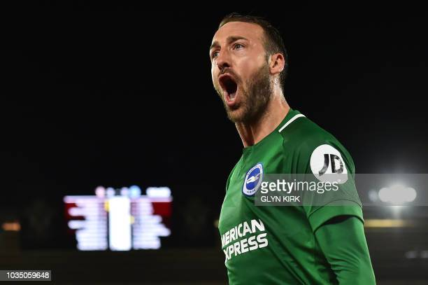Brighton's English striker Glenn Murray celebrates after scoring the penalty goal during the English Premier League football match between...