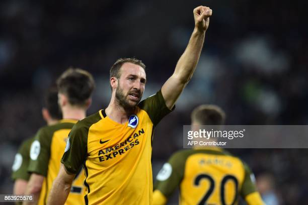 Brighton's English striker Glenn Murray celebrates after scoring their third goal from the penalty spot during the English Premier League football...