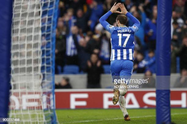 Brighton's English striker Glenn Murray celebrates after scoring their second goal during the English Premier League football match between Brighton...