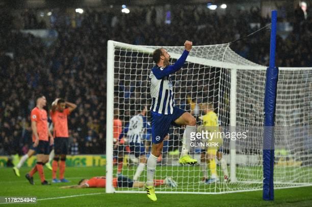 Brighton's English striker Glenn Murray celebrates an own goal scored by Everton's French defender Lucas Digne for Brighton's third goal to take the...