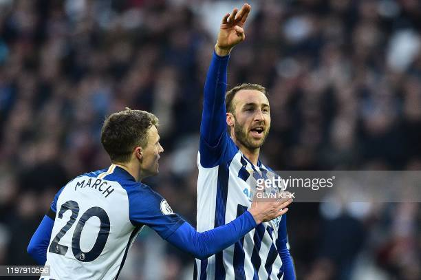 Brighton's English striker Glenn Murray celebrates scoring his team's third goal with Brighton's English midfielder Solly March during the English...