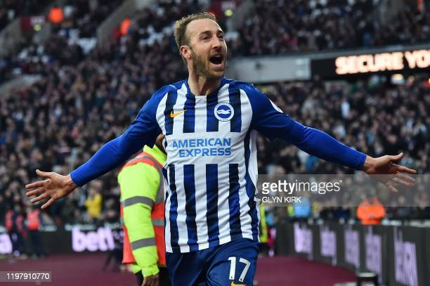 Brighton's English striker Glenn Murray celebrates scoring his team's third goal during the English Premier League football match between West Ham...