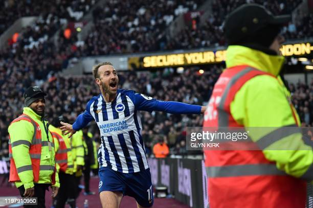 Brighton's English striker Glenn Murray celebrates scoring his team's third goal during the English Premier League football match between West Ham...