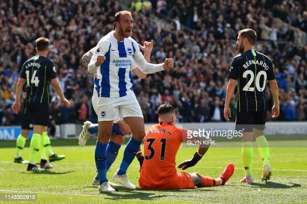 Brighton's English striker Glenn Murray celebrates scoring the opening goal during the English Premier League football match between Brighton and...