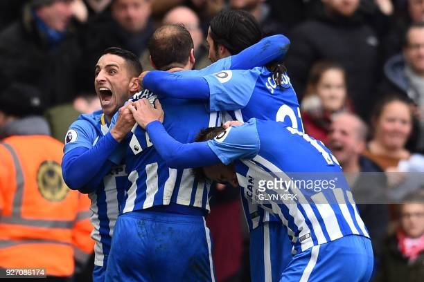 Brighton's English striker Glenn Murray celebrates with Brighton's French midfielder Anthony Knockaert and teammates after scoring their second goal...