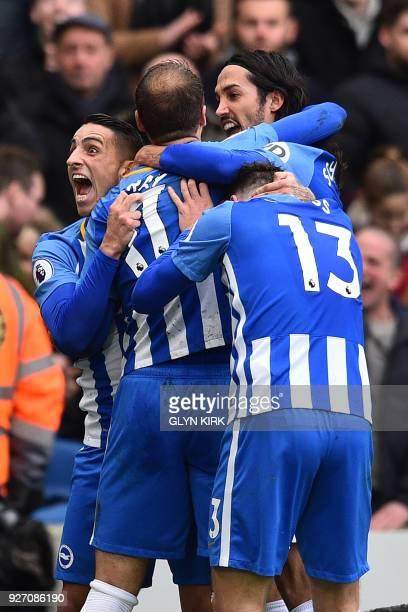 Brighton's English striker Glenn Murray celebrates with Brighton's French midfielder Anthony Knockaert and teammates after scoring their second goal...