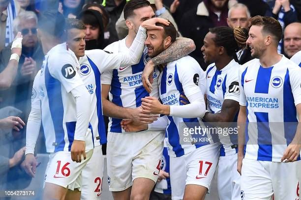 Brighton's English striker Glenn Murray celebrates with teammates after scoring his 100th Brighton goal the opening goal of the English Premier...