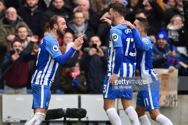 Brighton's English striker Glenn Murray celebrates with teammates after scoring their second goal during the English Premier League football match...