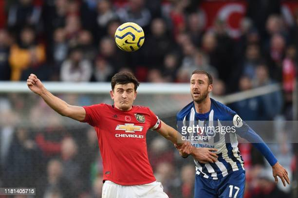 Brighton's English striker Glenn Murray challenges Manchester United's English defender Harry Maguire during the English Premier League football...