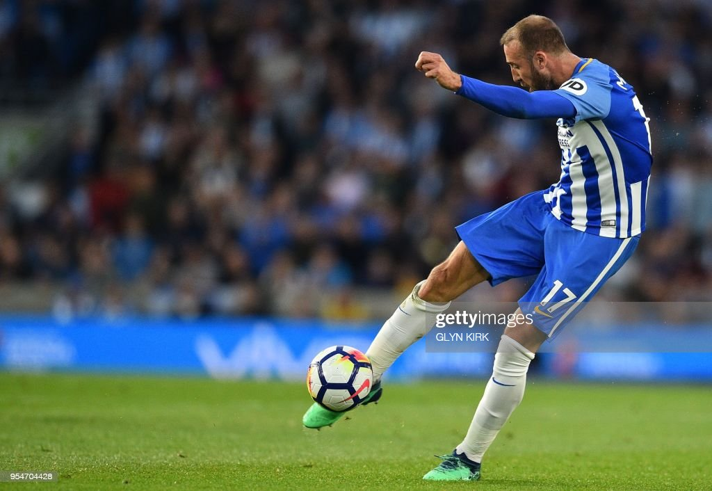 Brighton's English striker Glenn Murray has this long-range shot saved during the English Premier League football match between Brighton and Hove Albion and Manchester United at the American Express Community Stadium in Brighton, southern England on May 4, 2018. (Photo by Glyn KIRK / AFP) / RESTRICTED TO EDITORIAL USE. No use with unauthorized audio, video, data, fixture lists, club/league logos or 'live' services. Online in-match use limited to 75 images, no video emulation. No use in betting, games or single club/league/player publications. /