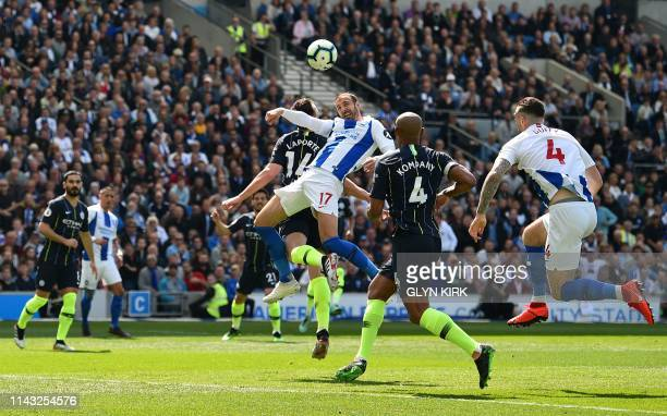 Brighton's English striker Glenn Murray jumps to head the ball during the English Premier League football match between Brighton and Hove Albion and...