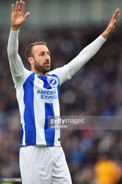 Brighton's English striker Glenn Murray reacts after scoring his 100th Brighton goal the opening goal of the English Premier League football match...