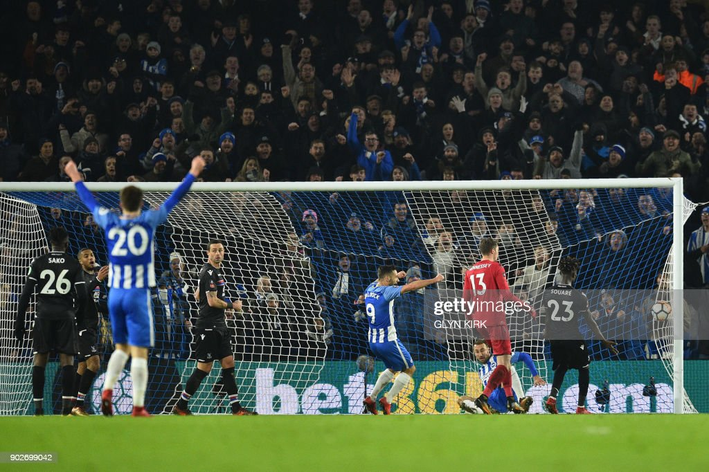 Brighton's English striker Glenn Murray scores the team's second goal during the English FA Cup third round football match between Brighton and Hove Albion and Crystal Palace at the American Express Community Stadium in Brighton, southern England on January 8, 2018. / AFP PHOTO / Glyn KIRK / RESTRICTED TO EDITORIAL USE. No use with unauthorized audio, video, data, fixture lists, club/league logos or 'live' services. Online in-match use limited to 75 images, no video emulation. No use in betting, games or single club/league/player publications. /