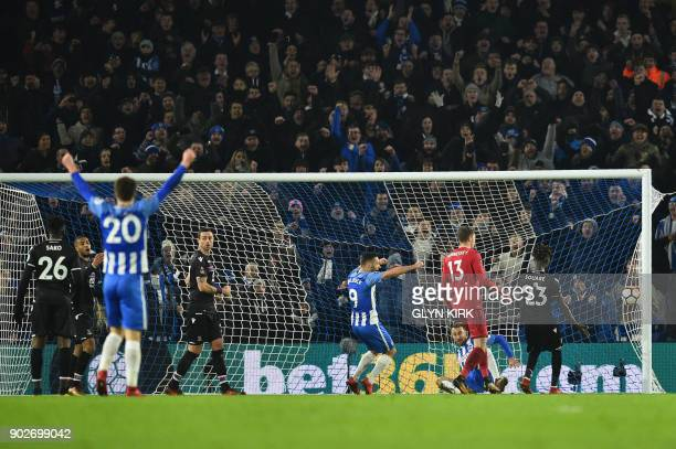 Brighton's English striker Glenn Murray scores the team's second goal during the English FA Cup third round football match between Brighton and Hove...