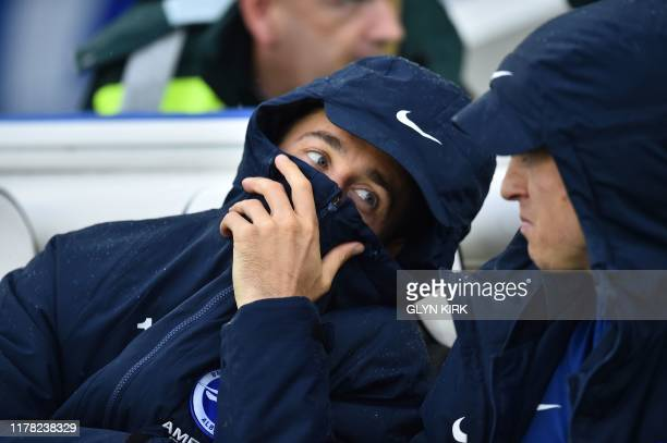 Brighton's English striker Glenn Murray sits on the bench during the English Premier League football match between Brighton and Hove Albion and...
