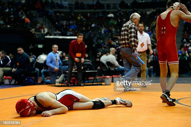 Brighton's Eric Yamaguchi lies on the mat exhausted after giving up an overtime-forcing takedown to Regis Jesuit's Josh Redman during the Colorado...