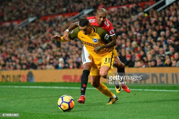Brighton's French midfielder Anthony Knockaert battles with Manchester United's English midfielder Ashley Young during the English Premier League...