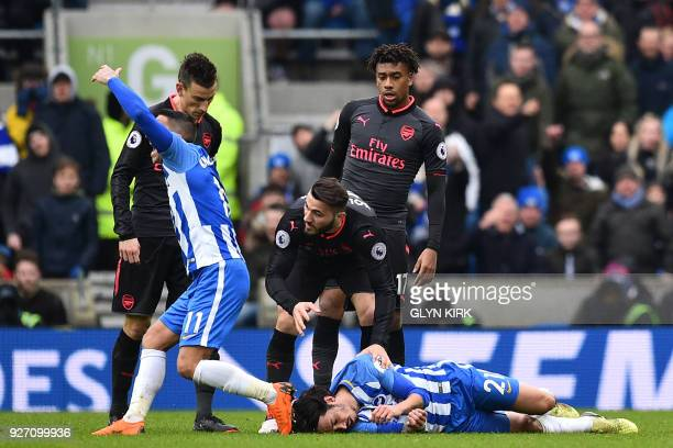 Brighton's French midfielder Anthony Knockaert calls for assistance as Brighton's Argentineborn Italian defender Ezequiel Schelotto is knocked to the...