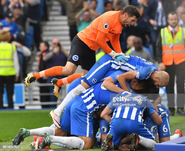 Brighton's French midfielder Anthony Knockaert celebrates with teammates scoring his team's first goal during the English Premier League football...