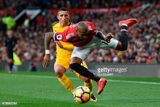 Brighton's French midfielder Anthony Knockaert fouls Manchester United's English midfielder Ashley Young during the English Premier League football...