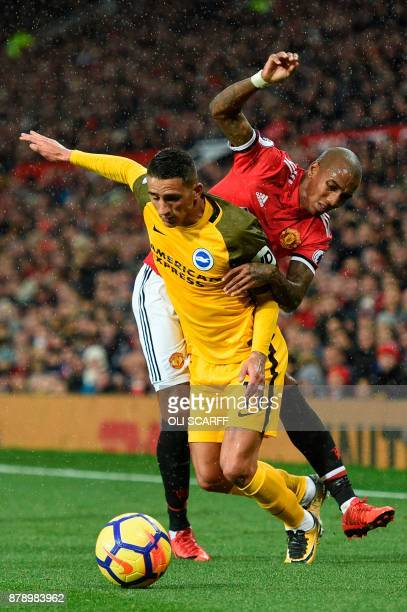 Brighton's French midfielder Anthony Knockaert is fouled by Manchester United's English midfielder Ashley Young during the English Premier League...