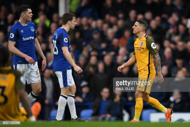 Brighton's French midfielder Anthony Knockaert remonstrates with Everton's Irish defender Seamus Coleman as he leaves the pitch after receiving a red...