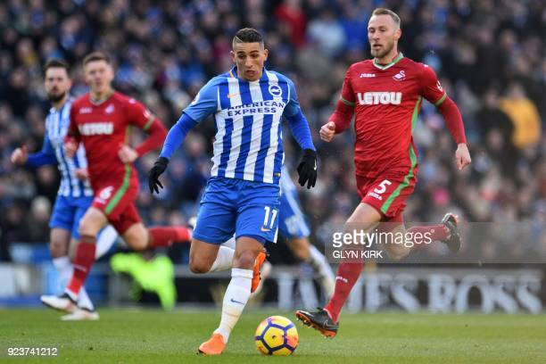 Brighton's French midfielder Anthony Knockaert runs with the ball during the English Premier League football match between Brighton and Hove Albion...