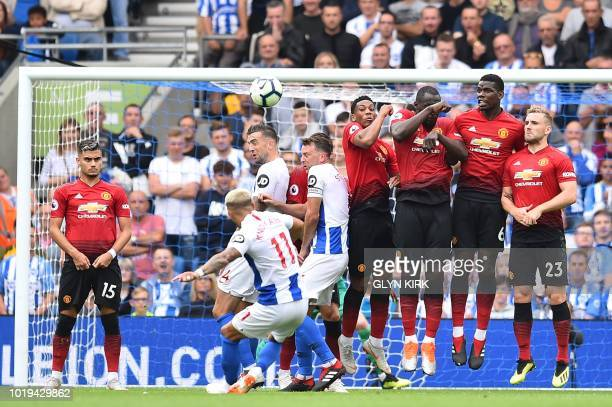Brighton's French midfielder Anthony Knockaert sends his free kick over the defensive wall and over the crossbar during the English Premier League...