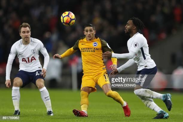 Brighton's French midfielder Anthony Knockaert vies with Tottenham Hotspur's English defender Danny Rose and Tottenham Hotspur's Danish midfielder...