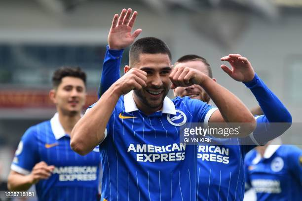 Brighton's French striker Neal Maupay celebrates after he takes the penalty to score his team's first goal during the English Premier League football...