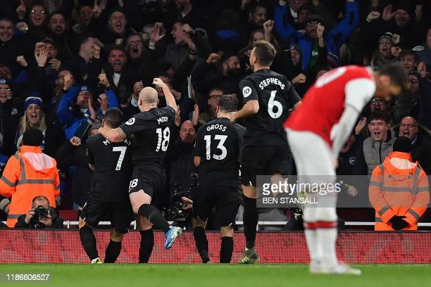Brighton's French striker Neal Maupay celebrates scoring his team's second goal during the English Premier League football match between Arsenal and...