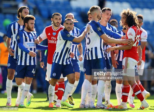 Brighton's French striker Neal Maupay is shielded from Arsenal's French midfielder Matteo Guendouzi after the English Premier League football match...