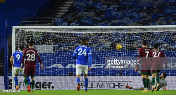 Brighton's French striker Neal Maupay scores their second goal from the penalty spot during the English Premier League football match between...
