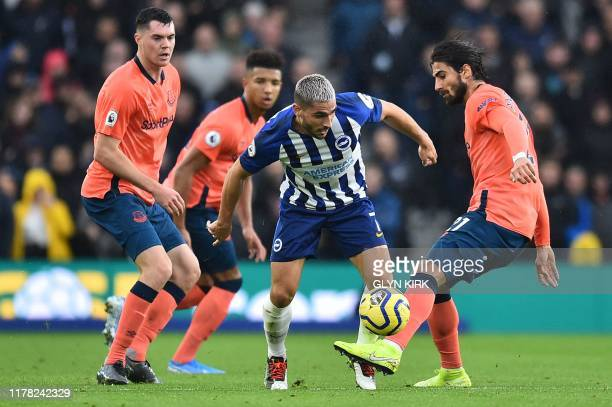 Brighton's French striker Neal Maupay takes on Everton's Portuguese midfielder André Gomes during the English Premier League football match between...