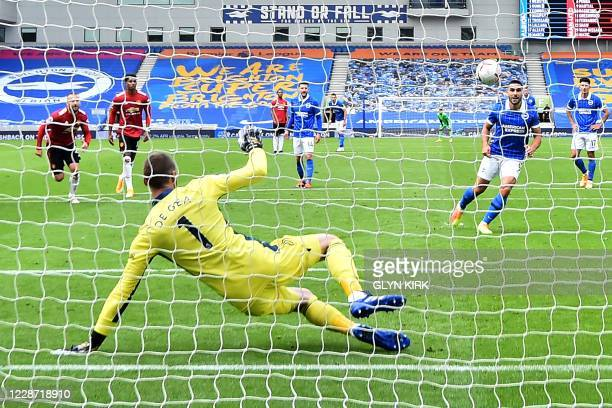 Brighton's French striker Neal Maupay takes the penalty and score his team's first goal during the English Premier League football match between...