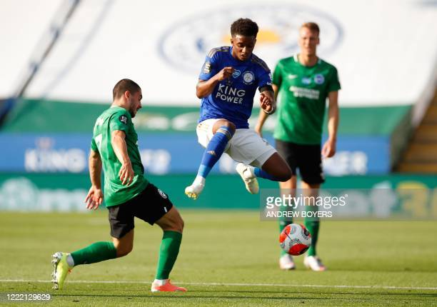 Brighton's French striker Neal Maupay vies for the ball with Leicester City's English midfielder Demarai Gray during the English Premier League...