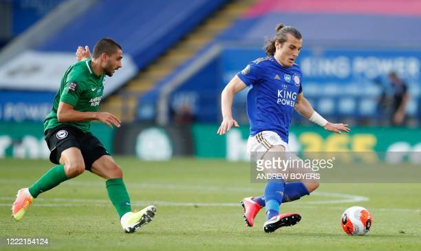 Brighton's French striker Neal Maupay vies Leicester City's Turkish defender Caglar Soyuncu during the English Premier League football match between...