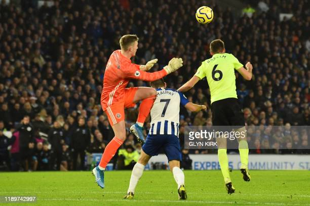 Brighton's French striker Neal Maupay vies with Sheffield United's English goalkeeper Dean Henderson and Sheffield United's English defender Chris...