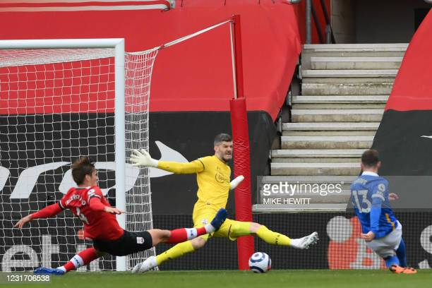 Brighton's German midfielder Pascal Gross has this shot saved by Southampton's English goalkeeper Fraser Forster during the English Premier League...