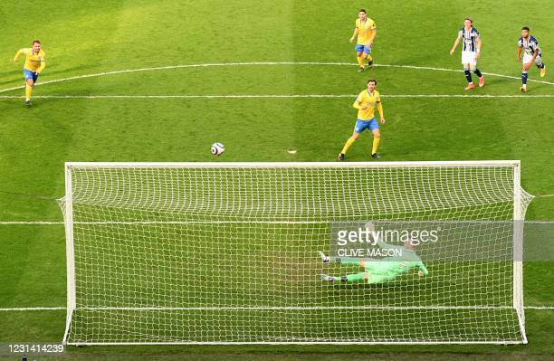 Brighton's German midfielder Pascal Gross watches his penalty shot rebound off of the crossbar during the English Premier League football match...