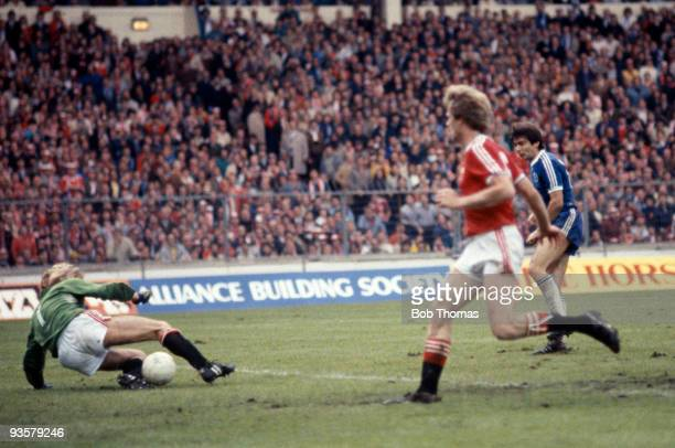 Brighton's Gordon Smith is foiled by Manchester United goalkeeper Gary Bailey in the last four minutes of extra time during the FA Cup Final between...