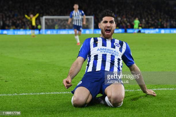 Brighton's Iranian midfielder Alireza Jahanbakhsh celebrates after Watford's Englishborn Jamaican defender Adrian Mariappa scores an own goal during...
